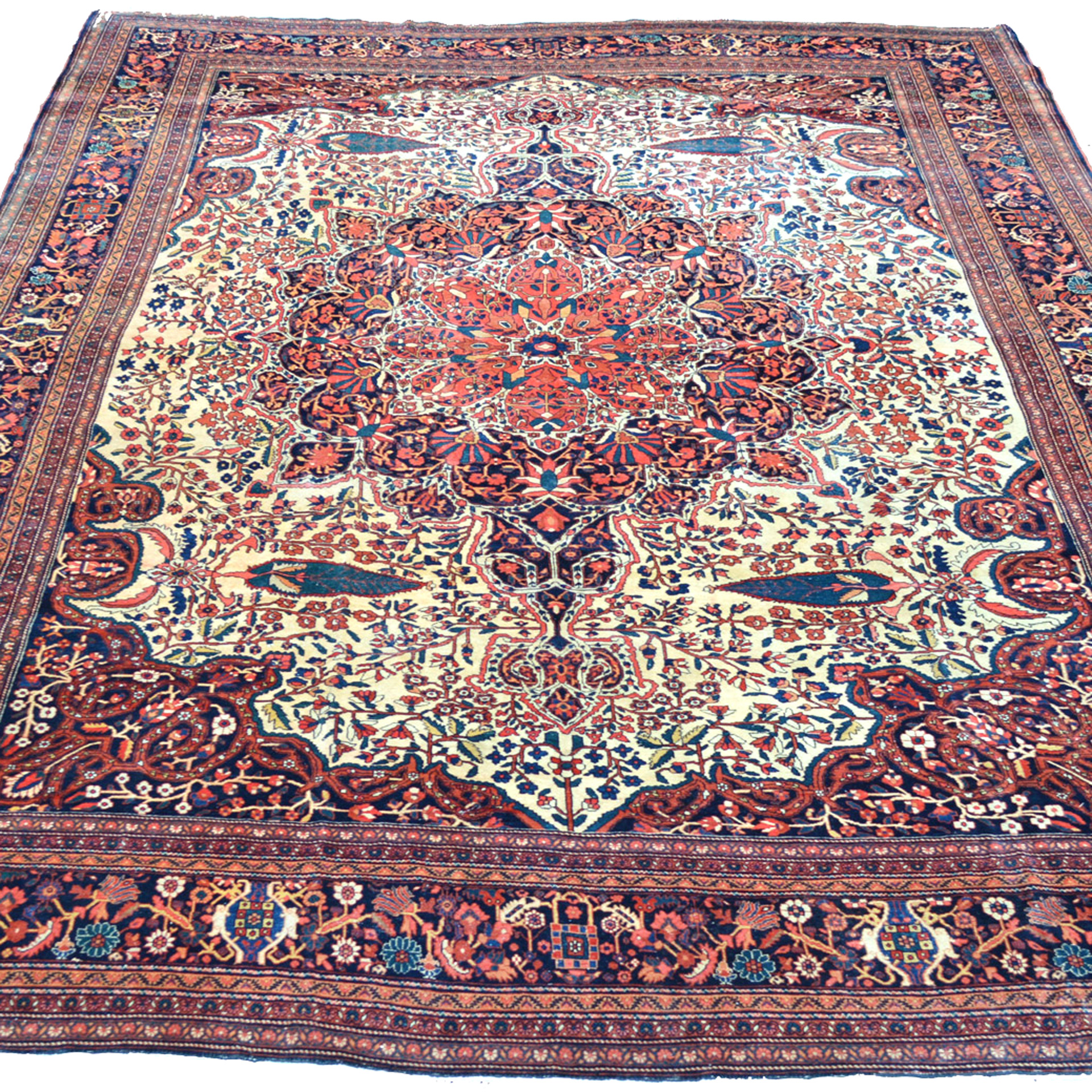 Antique Persian Fereghan Sarouk carpet with a medallion and Cypress Trees on an ivory field.