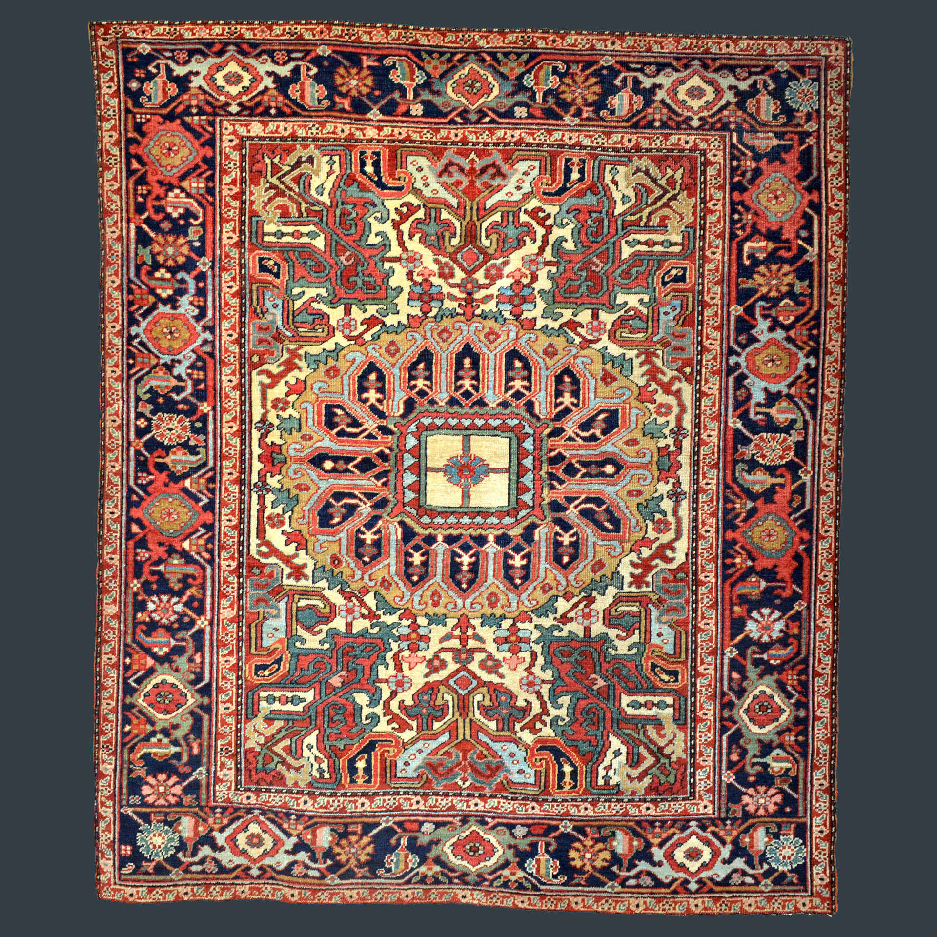 Antique Heriz Serapi rug with ivory field