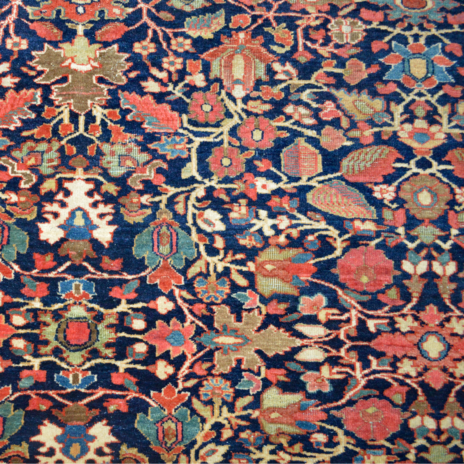 An over size antique Fereghan Sarouk carpet with an all-over design on a navy blue field - Douglas Stock Gallery, antique Persian carpets, Boston,MA area, antique Oriental rugs