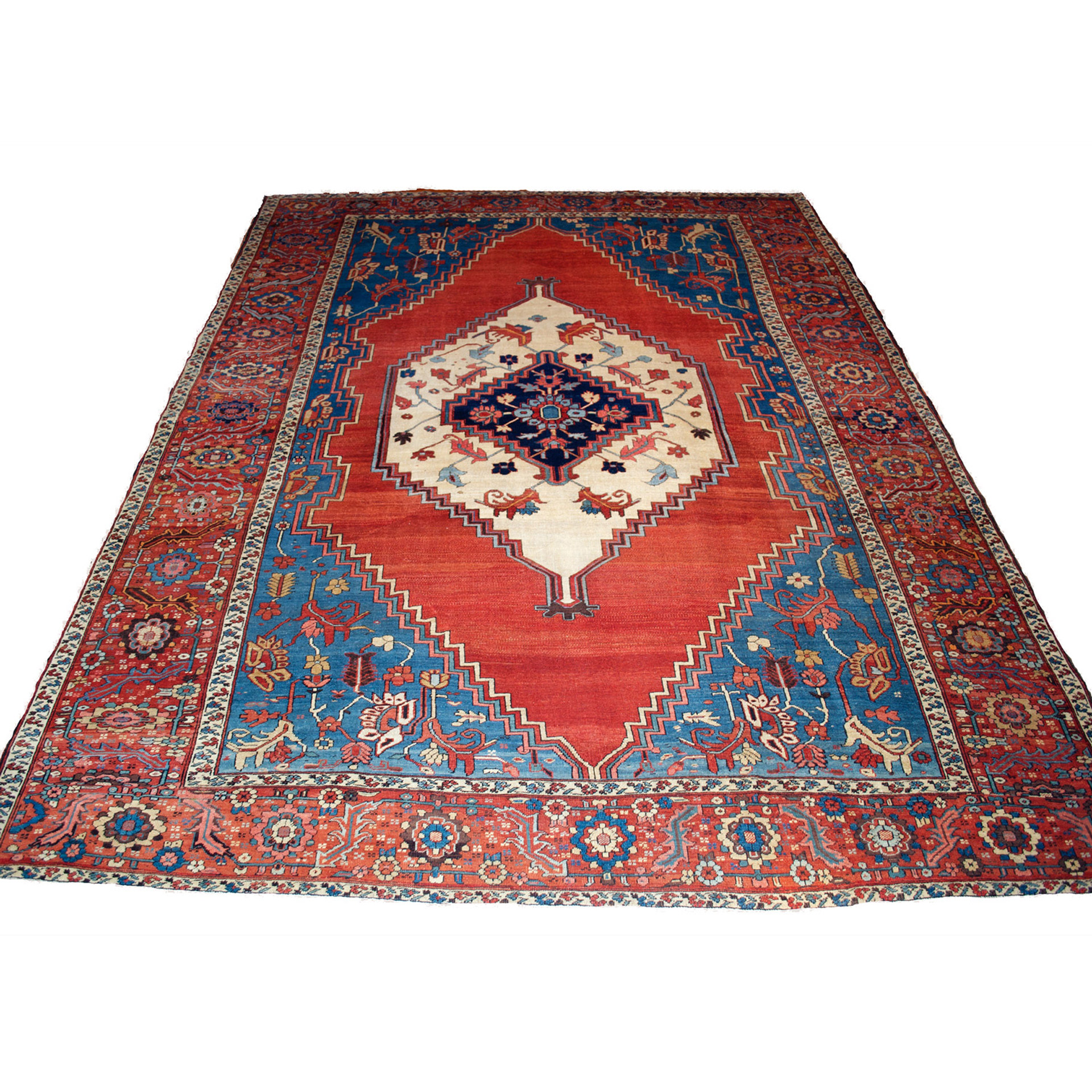 An antique Persian Bakshaish carpet from the Heriz district with an ivory medallion floating on a red open field, framed by sky blue spandrels and a brick red border