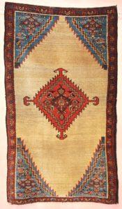 Antique northwest Persian Bakshaish rug with an ivory open field design