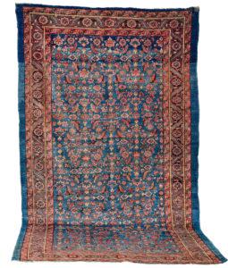Antique Persian Bakshaish rug with the classical Herati design on a denim blue field