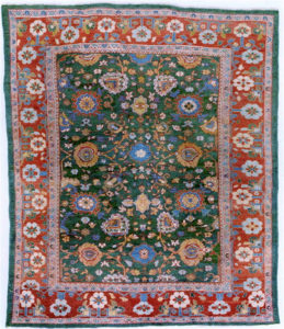 Antique Sultanabad carpet with green field