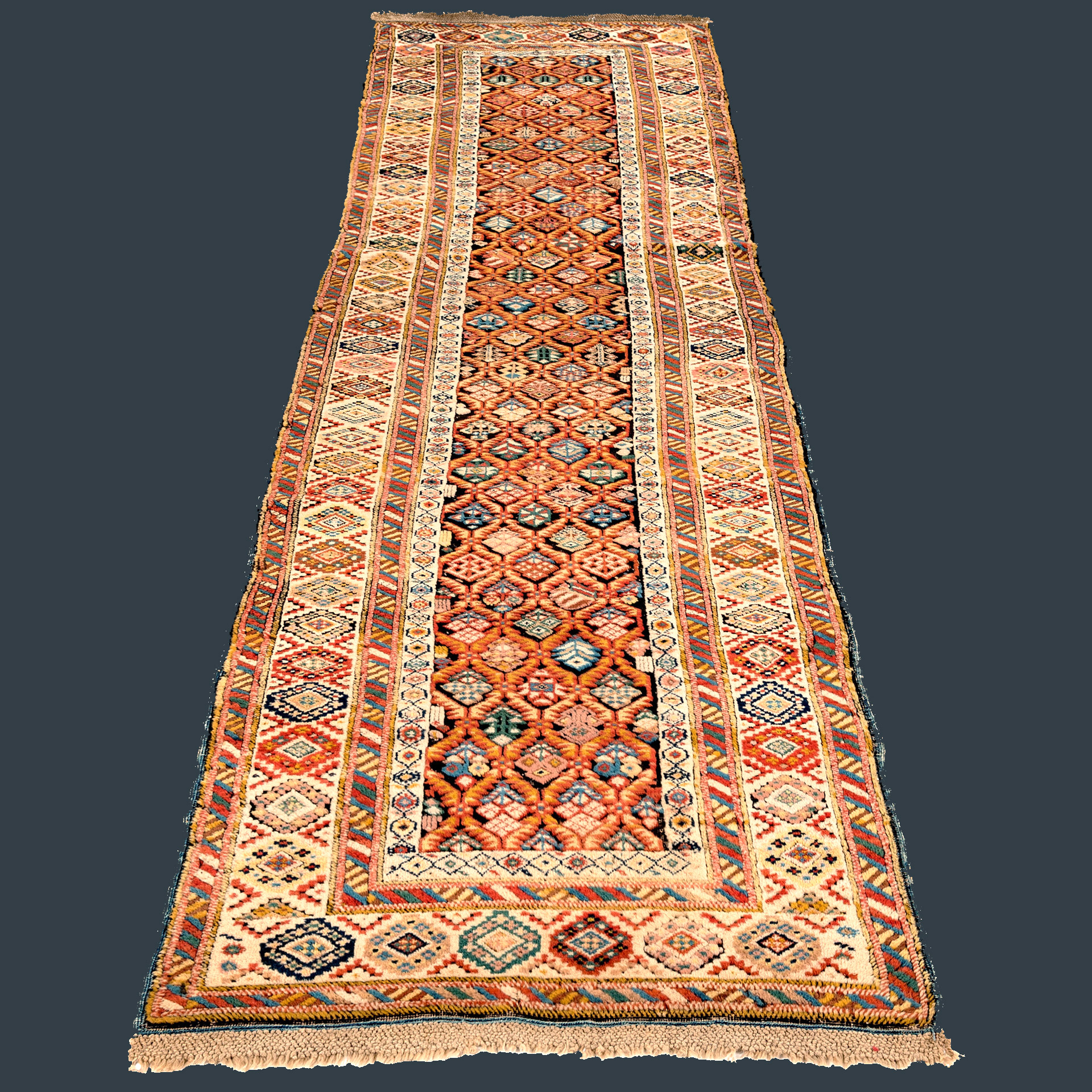 Antique Caucasian Kuba runner with oxidized brown field and lattice design framed by an ivory border