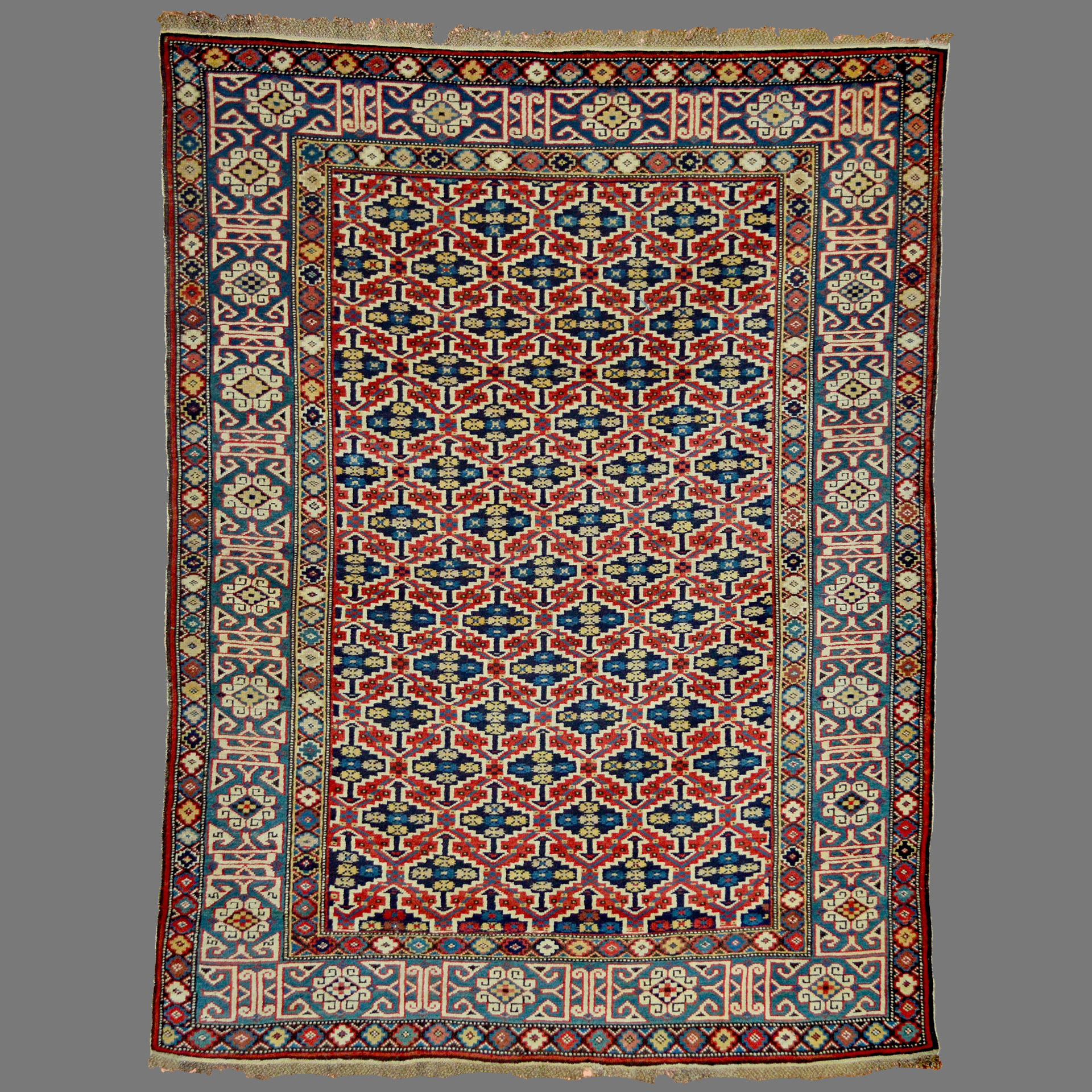 Antique Caucasian Kuba rug with a lattice design framed by a teal blue Kufic border