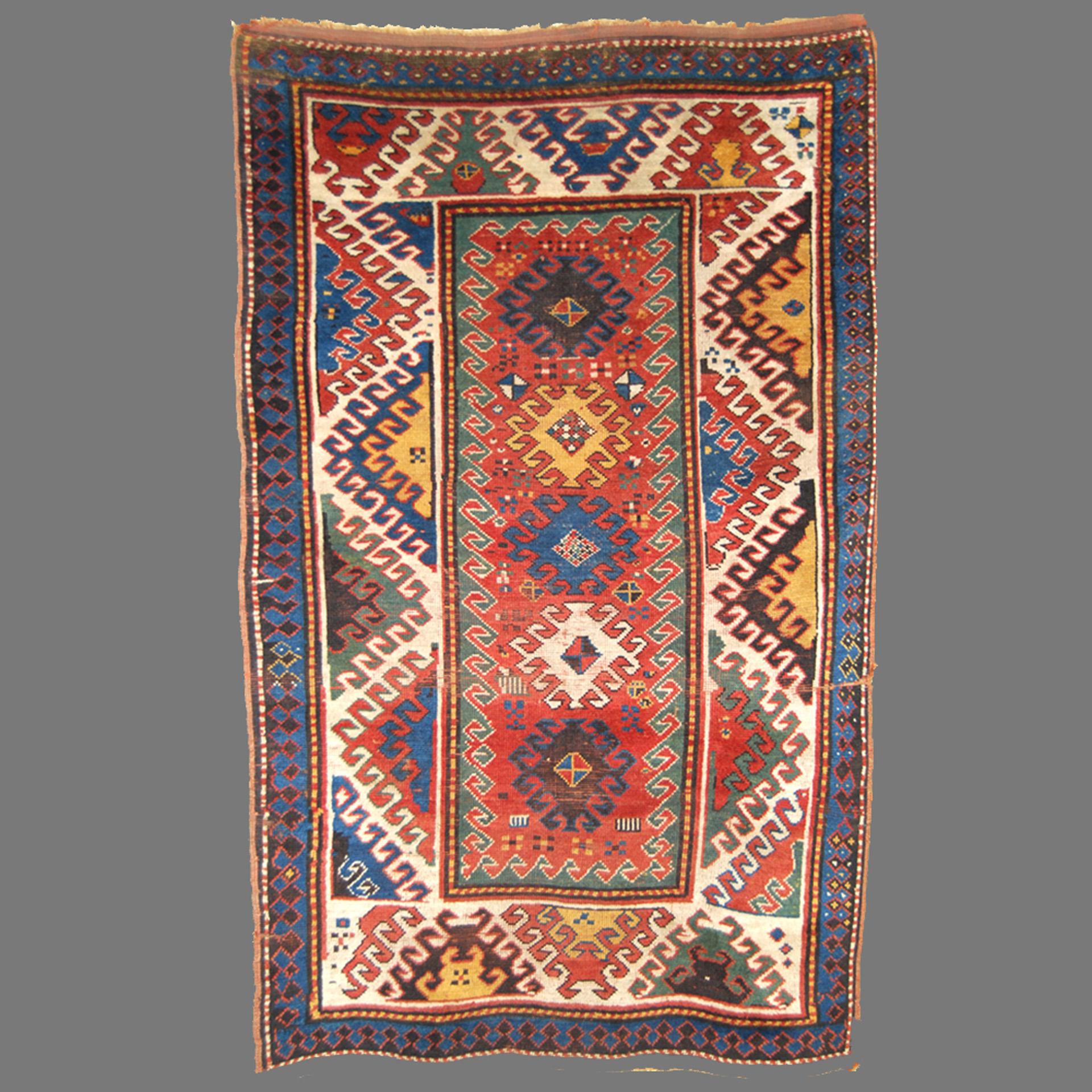 Antique Caucasian Bordjalou Kazak rug with a terra cotta field and an ivory eye dazzler border, circa 1890
