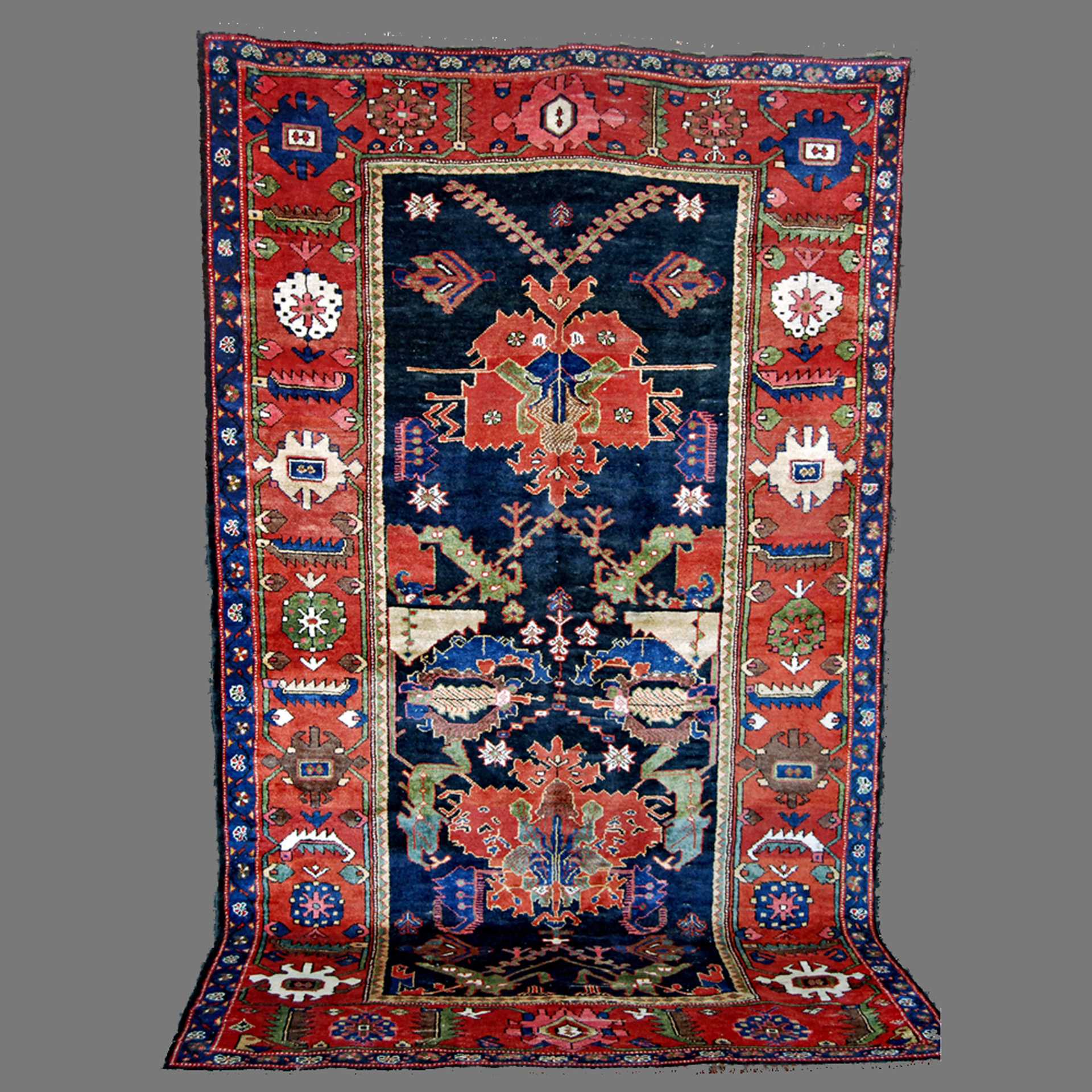 Antique south Persian Bakhtiyari tribal rug with a design based on early Caucasian Dragon Carpets