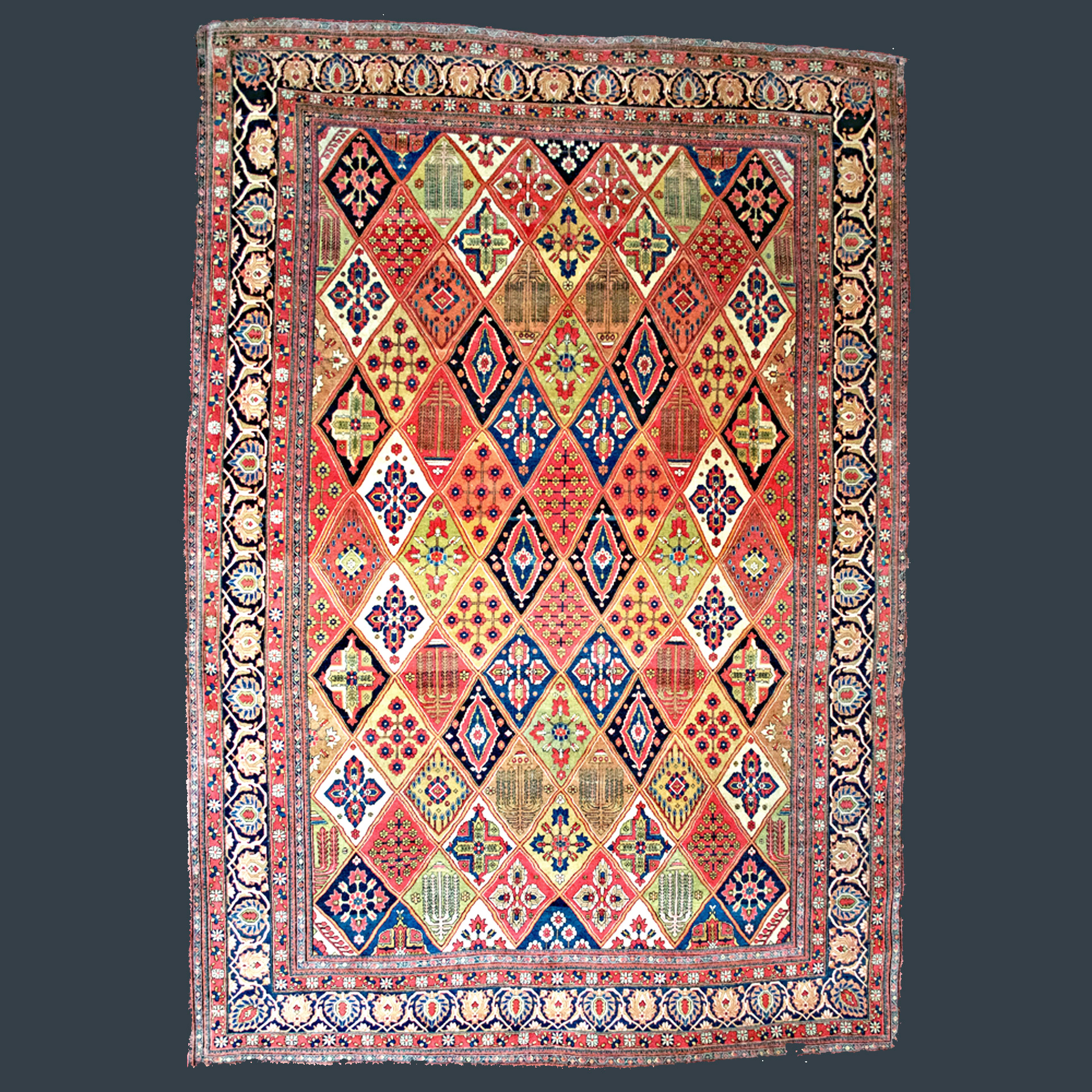 A world class antique Mohtasham Kashan carpet with a garden panel design