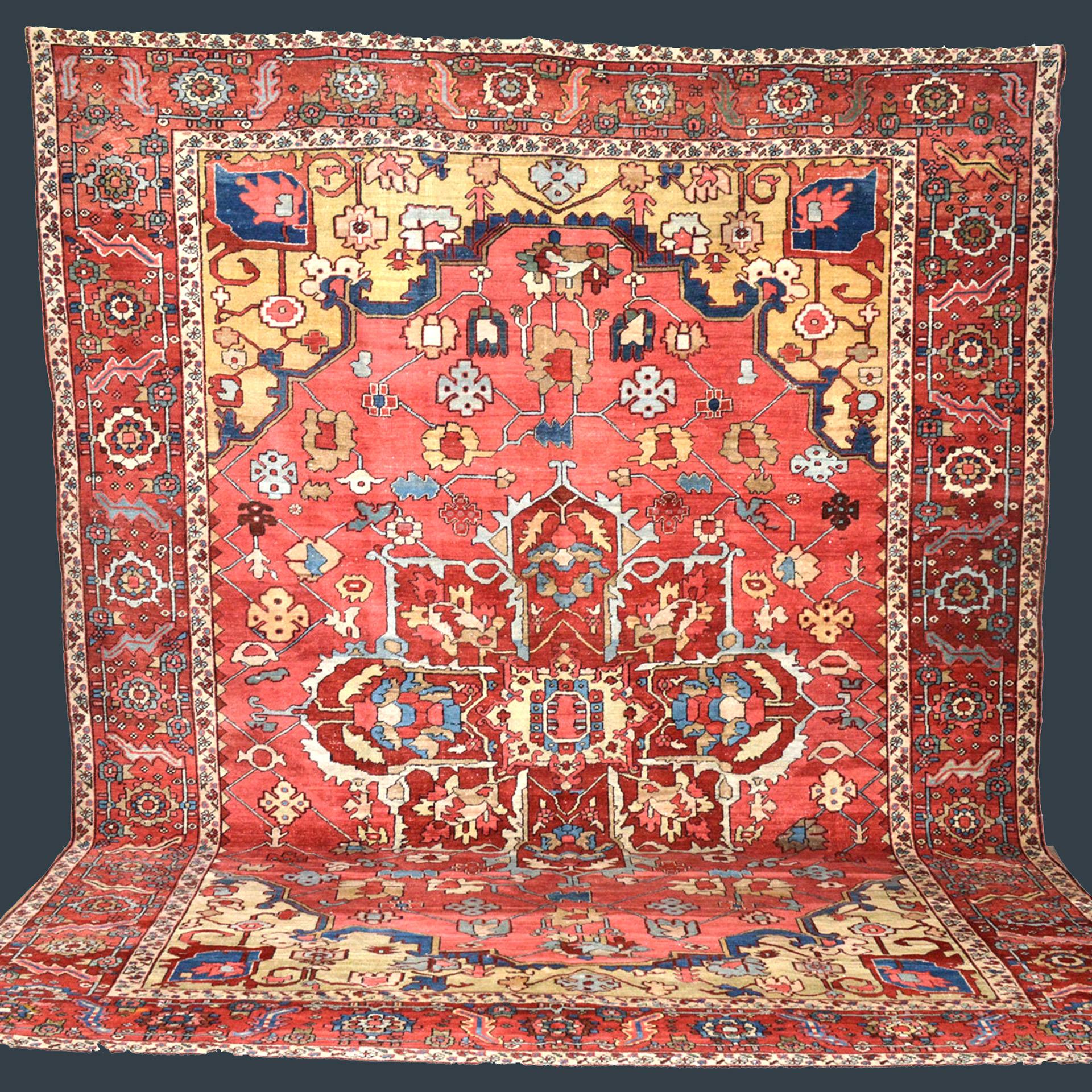 Antique Heriz Serapi carpet with coral color field