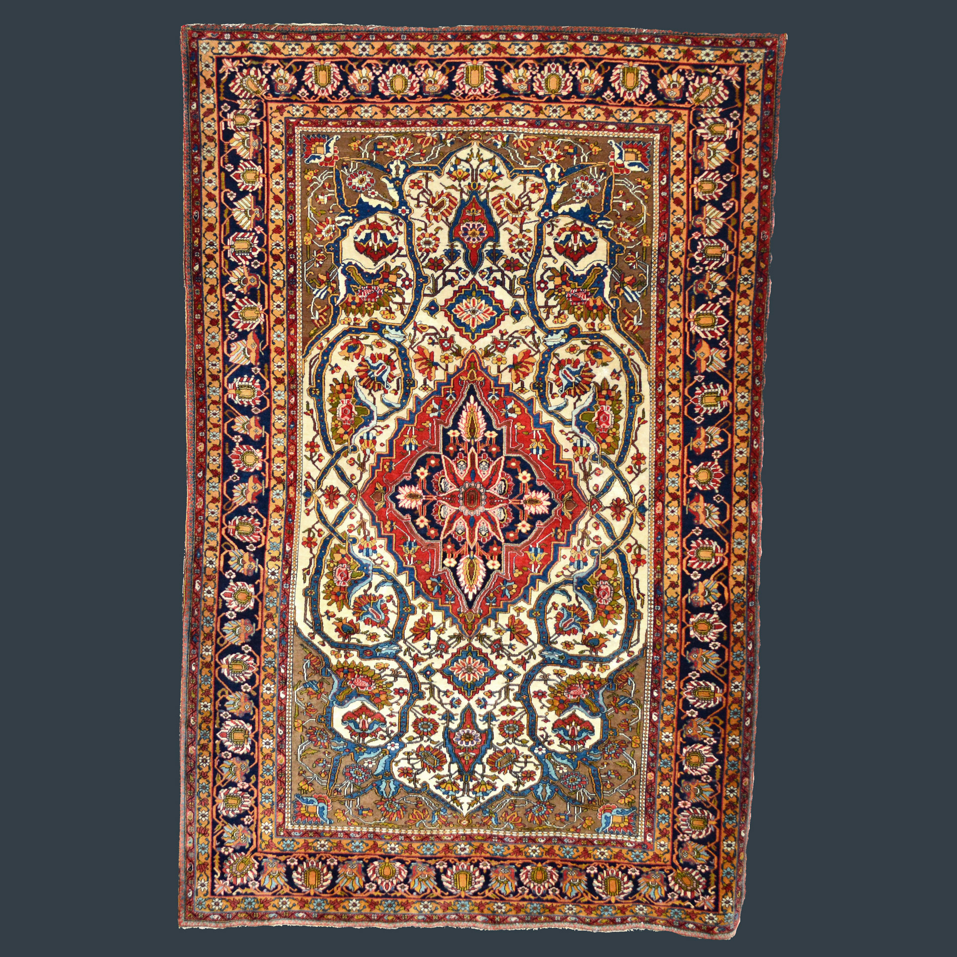 Antique Persian Mohtasham Kashan rug with an ivory field and navy blue border, circa 1890