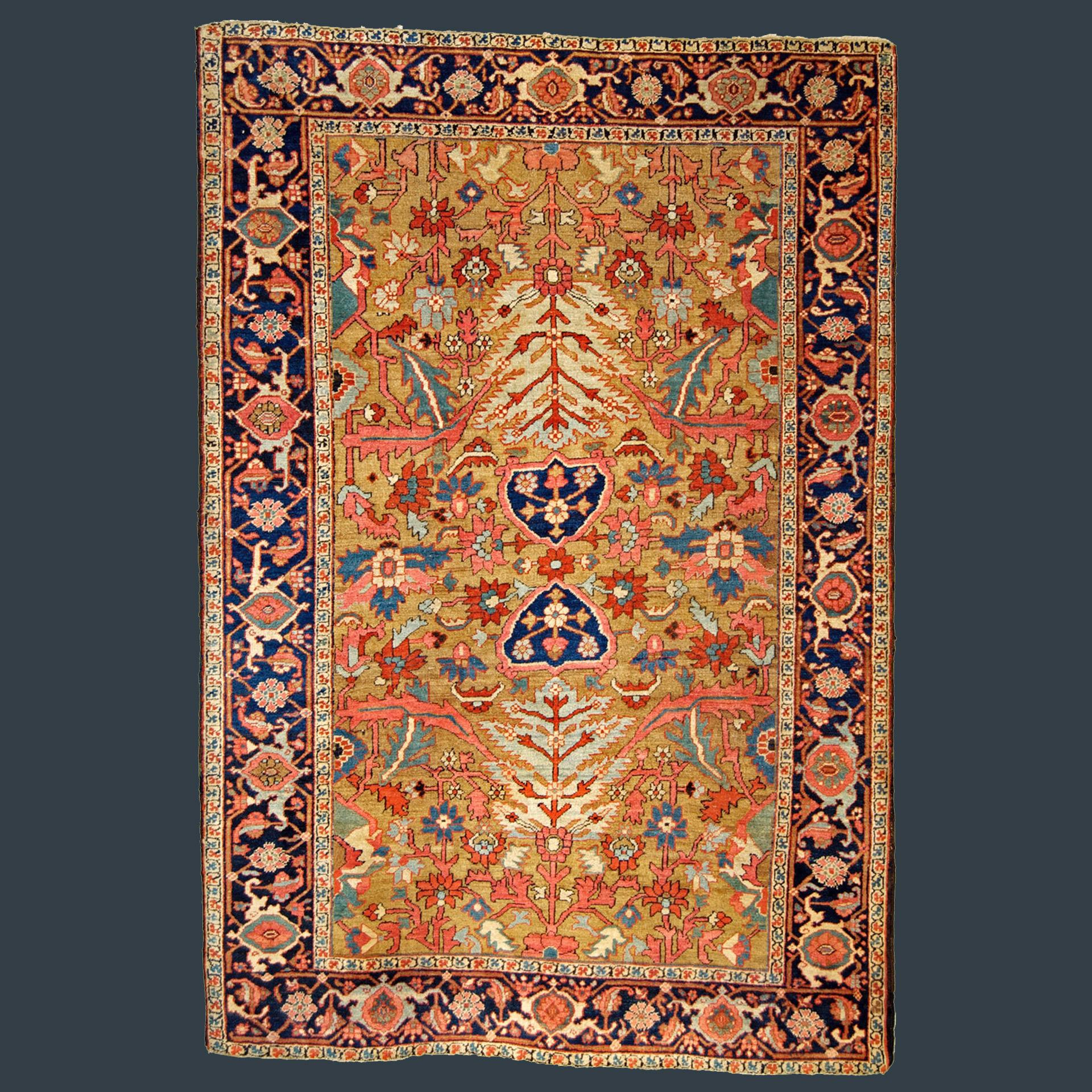 Antique Heriz Serapi rug with yellow-camel field