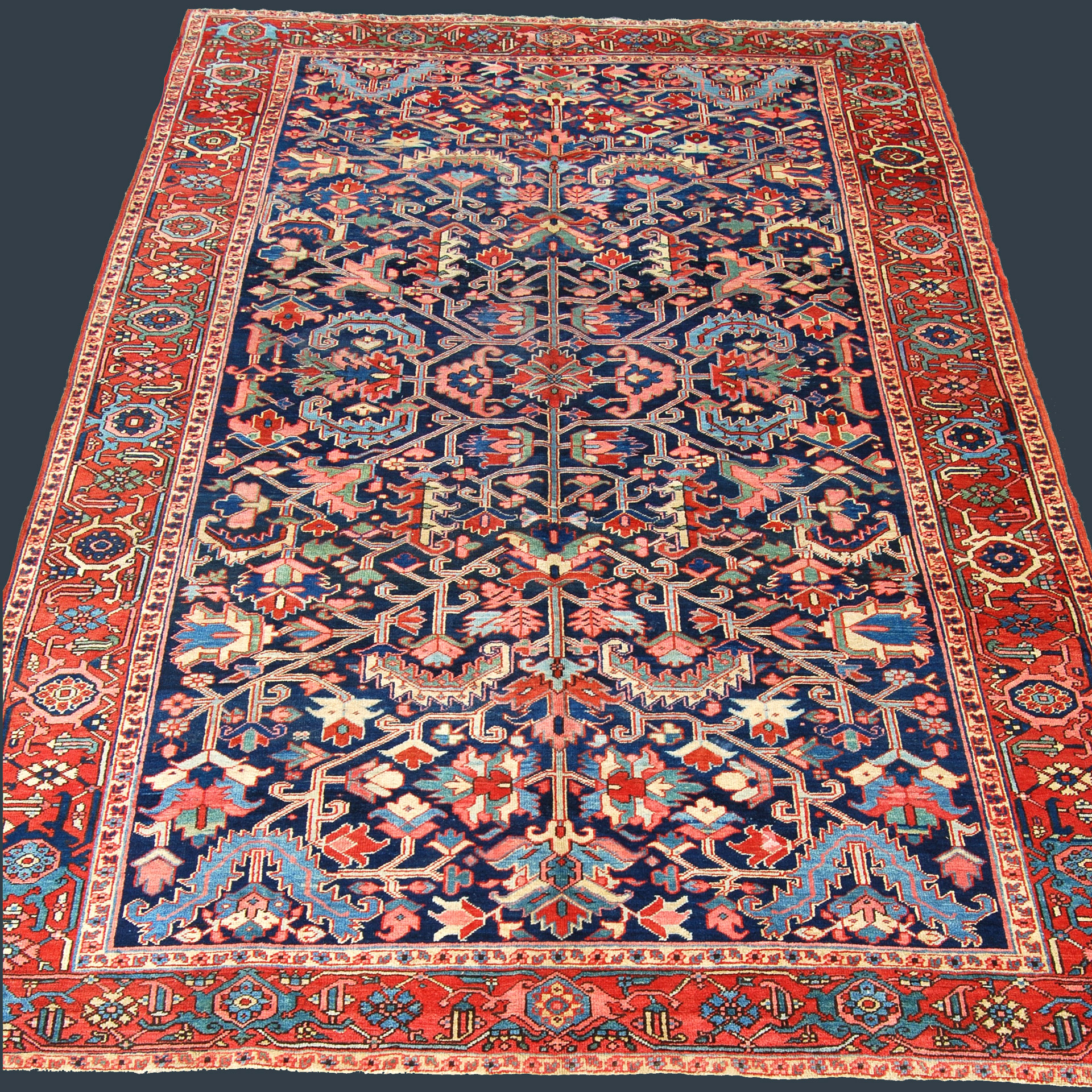 Antique Persian Heriz carpet with navy field and all-over design