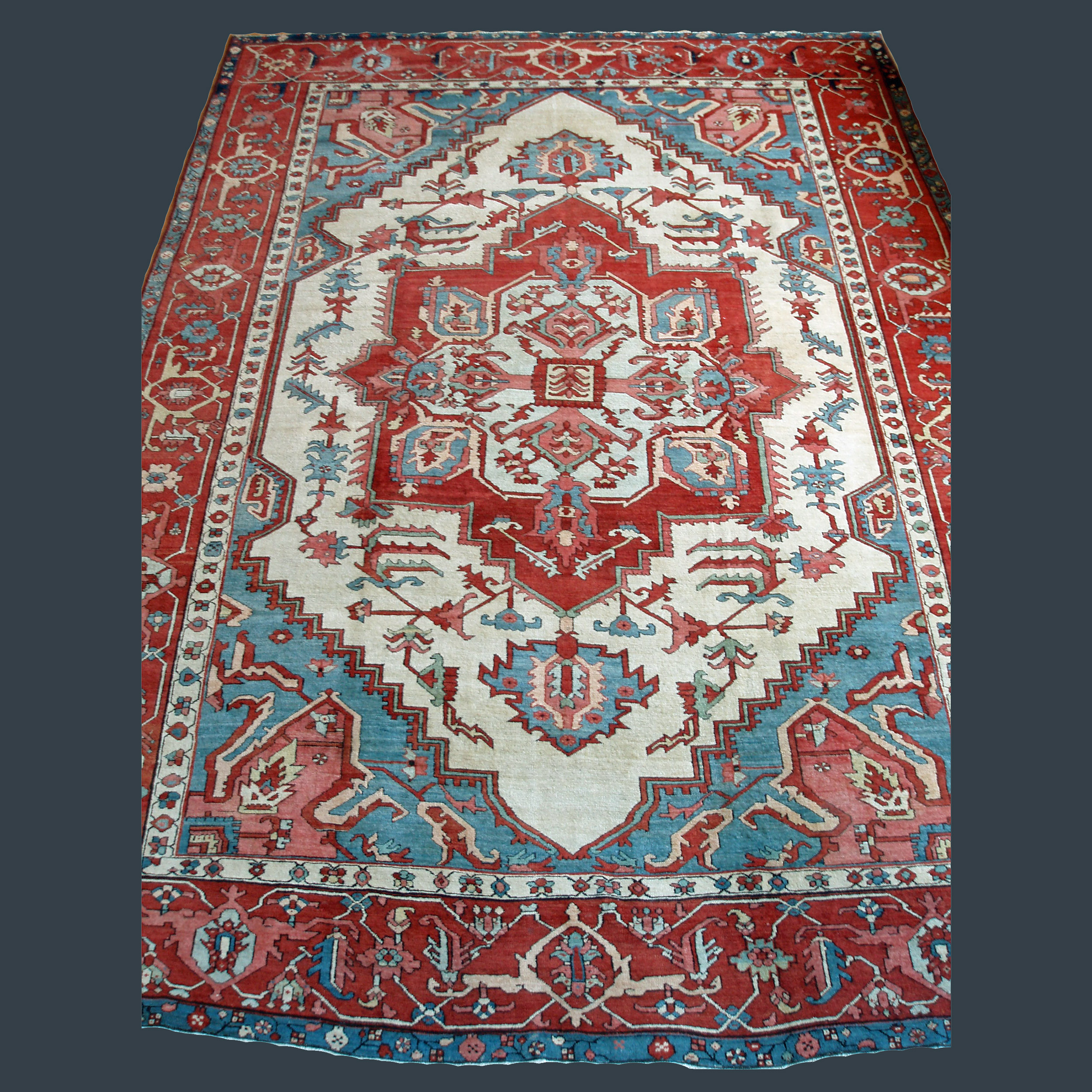 Antique Persian Heriz Serapi carpet with ivory field