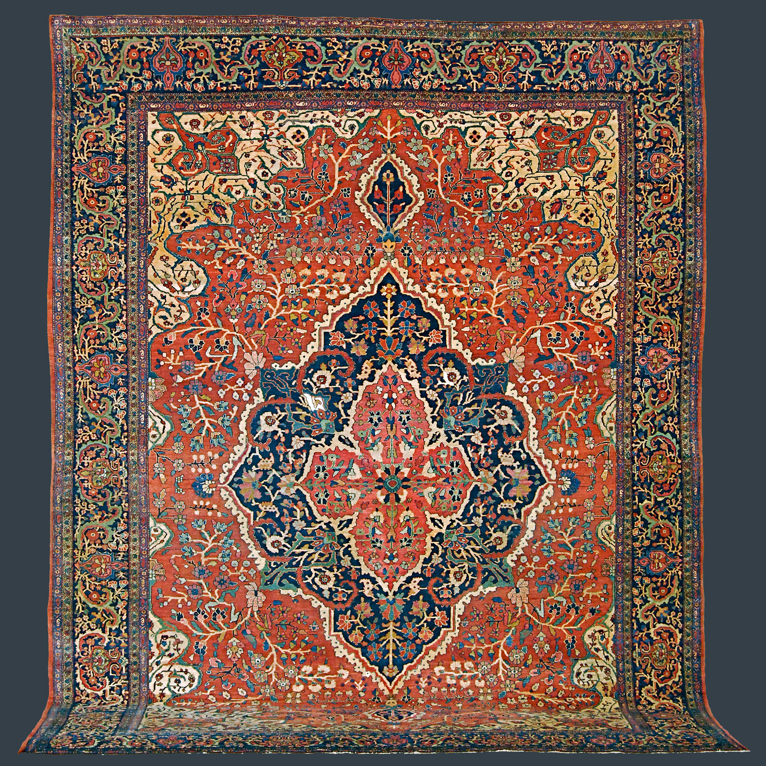 Antique Fereghan Sarouk carpet with a navy medallion on a salmon field