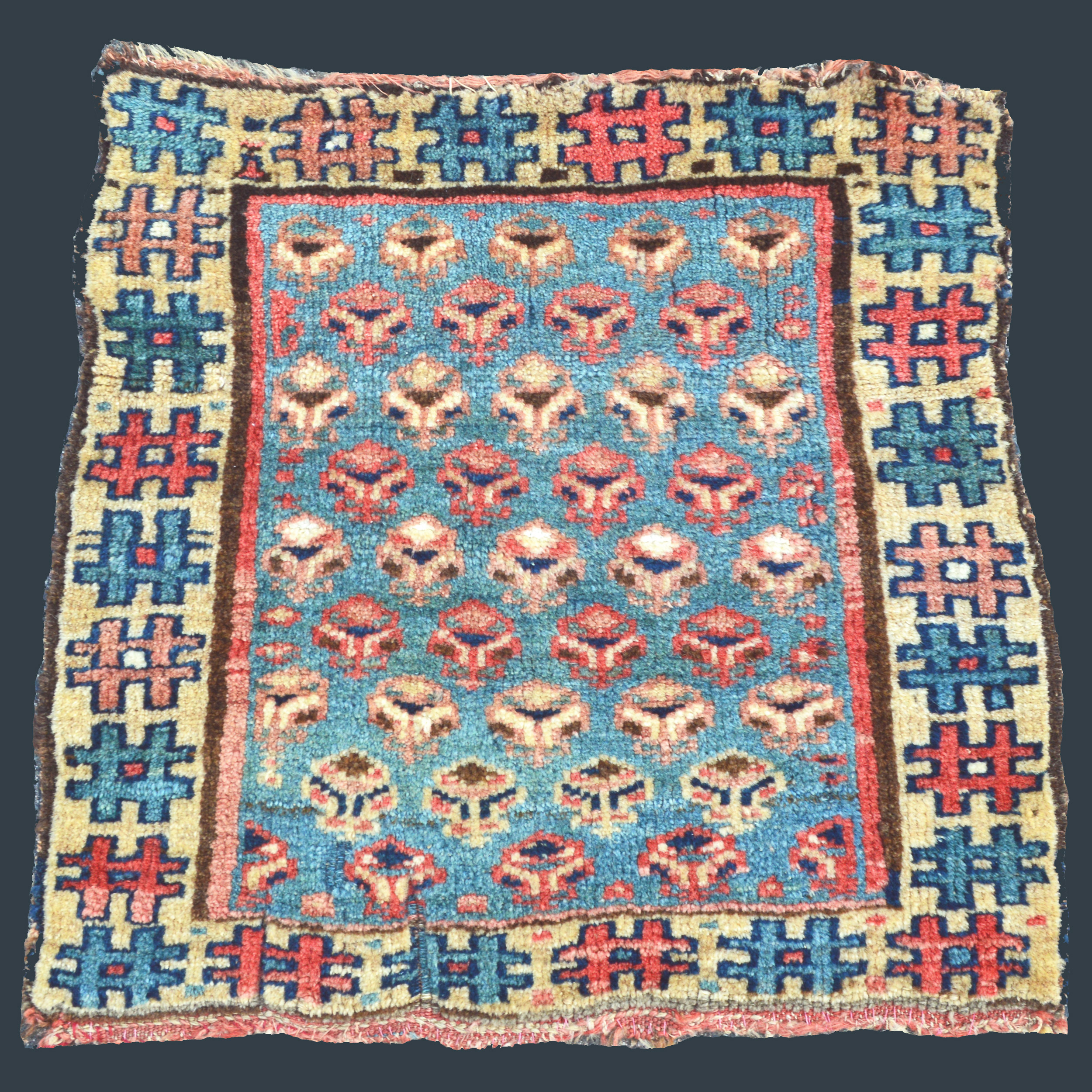 Antique northwest Persian Kurdish bag face with rows of flowers on an uncommon sky blue field - Douglas Stock Gallery antique Oriental rugs, Boston,MA area