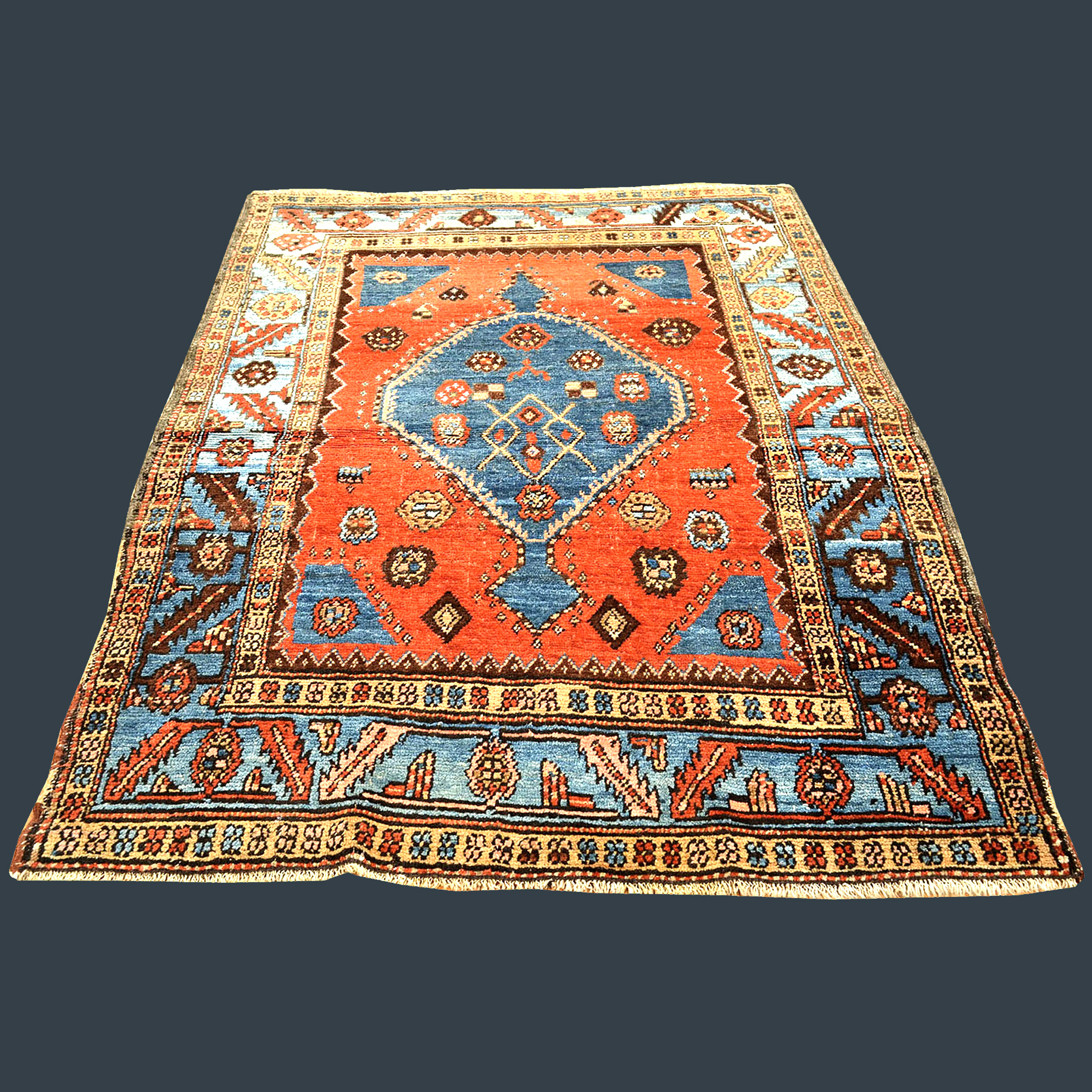 Antique Bakshaish rug with a denim blue medallion on a deep salmon color field that is framed by a sky blue border, northwest Persia, circa 1890 - Douglas Stock Gallery antique Oriental rugs research archives