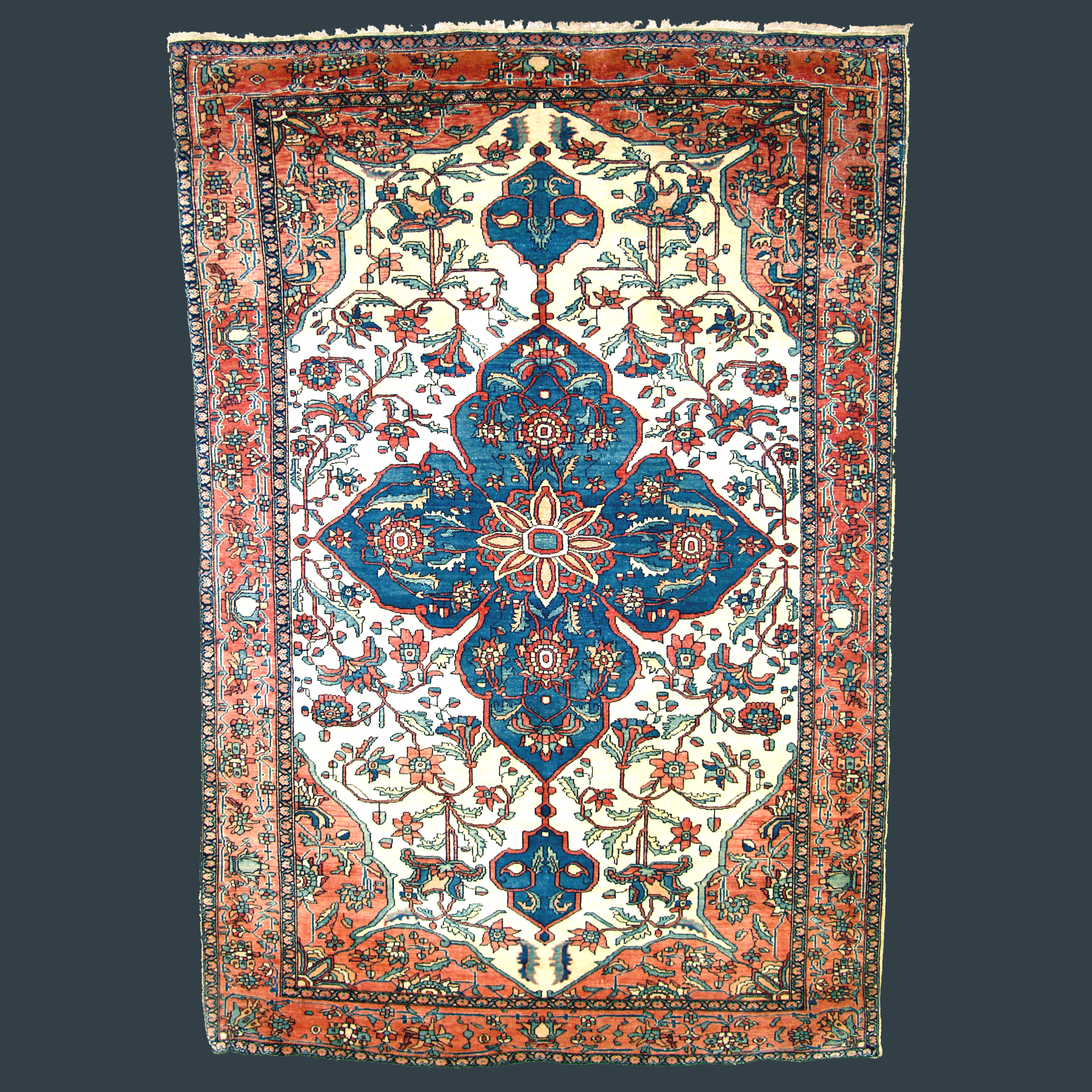 Antique Fereghan Sarouk rug with a denim blue, Quatrefoil style medallion on an ivory field, central Persia, circa 1880 - Douglas Stock Gallery antique Oriental rug research archives