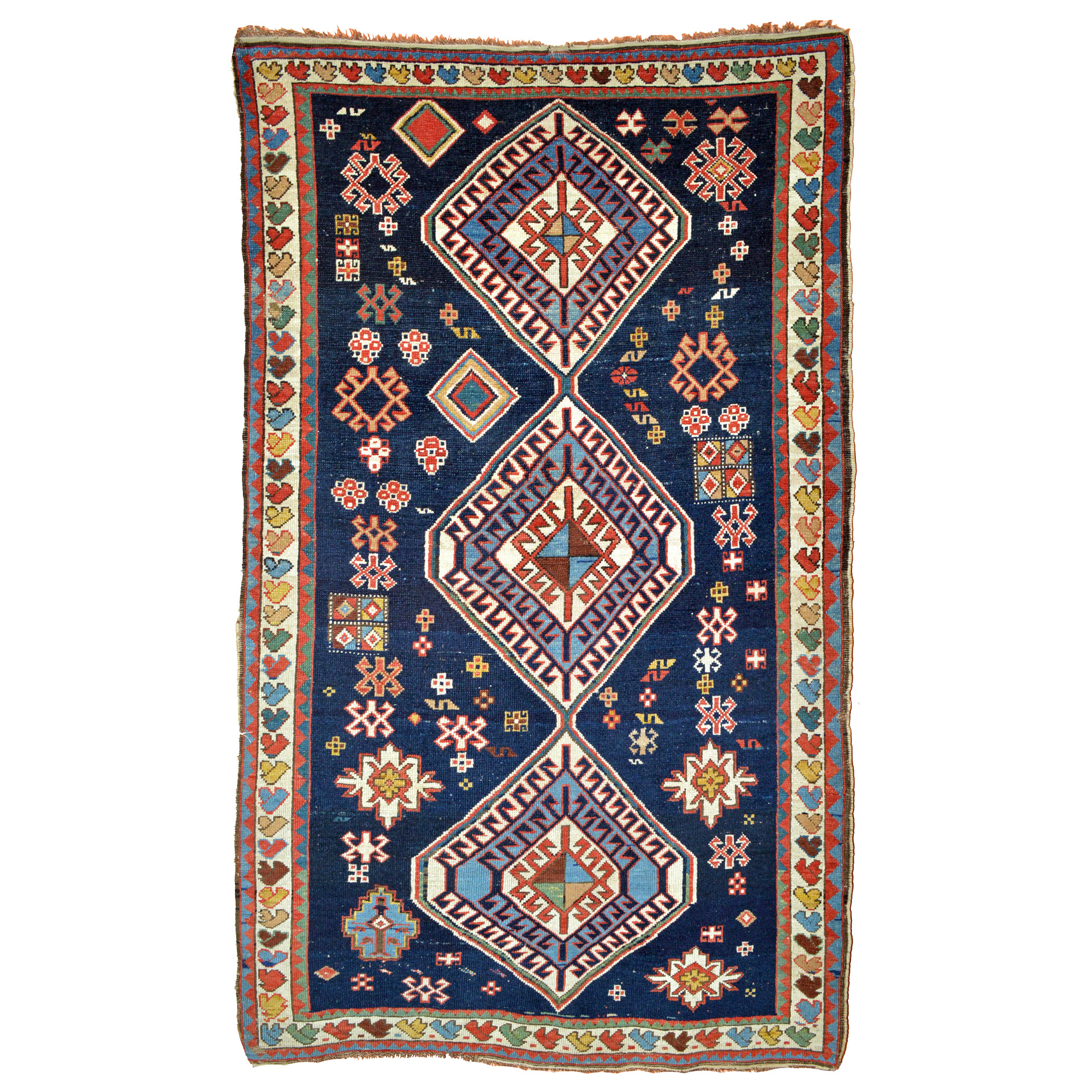 Antique Caucasian Shirvan rug with three medallions and ancillary geometric motifs on a navy blue field- Douglas Stock Gallery, antique Oriental rugs Boston, MA area New England