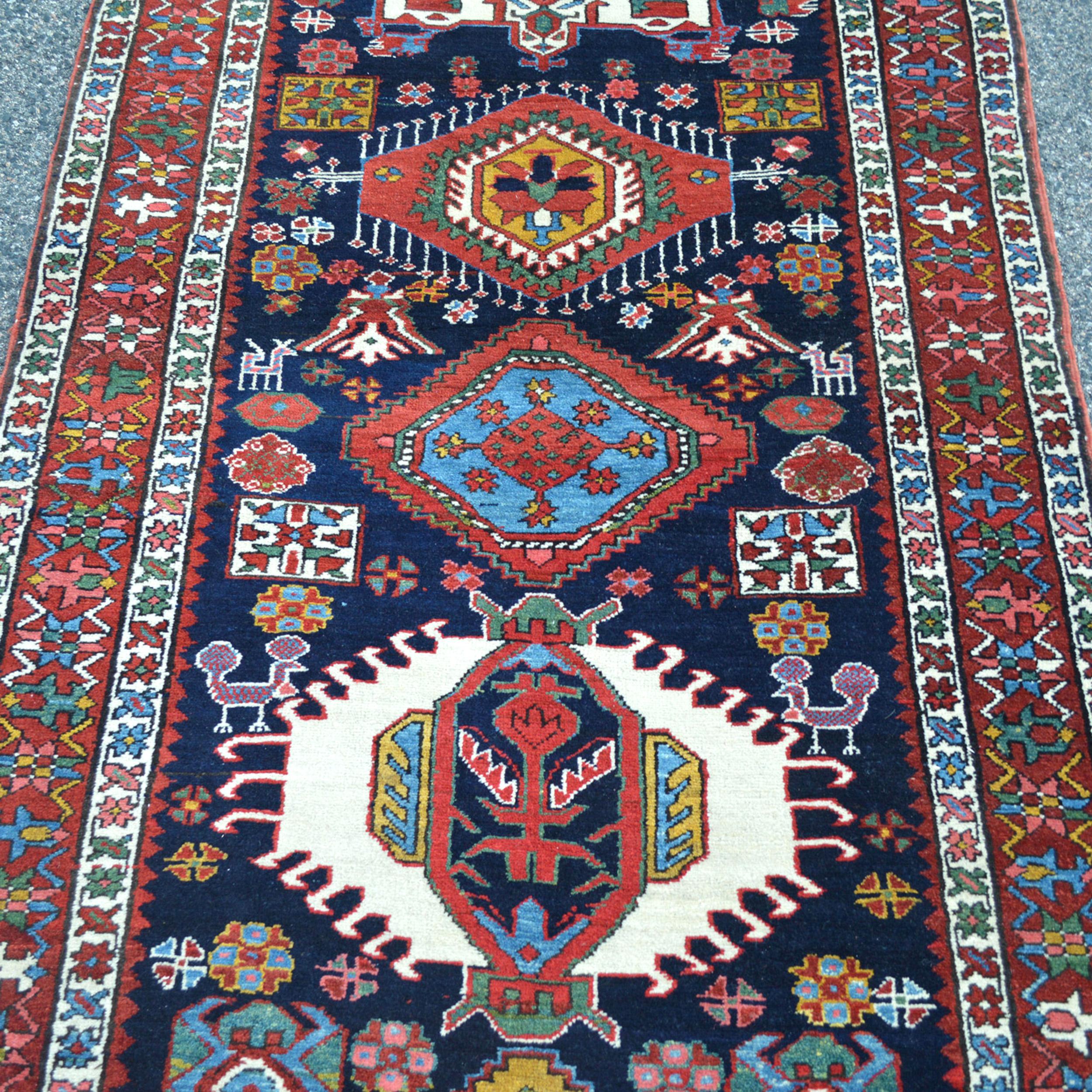 An unusually long antique Persian Heriz Serapi runner rug, antique runners